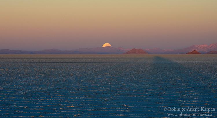 Full moon setting on Uyuni salt lake