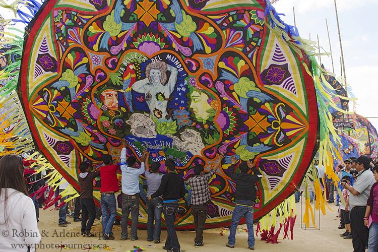 Hoisting up a giant kite, Sumpongo, Guatemala.