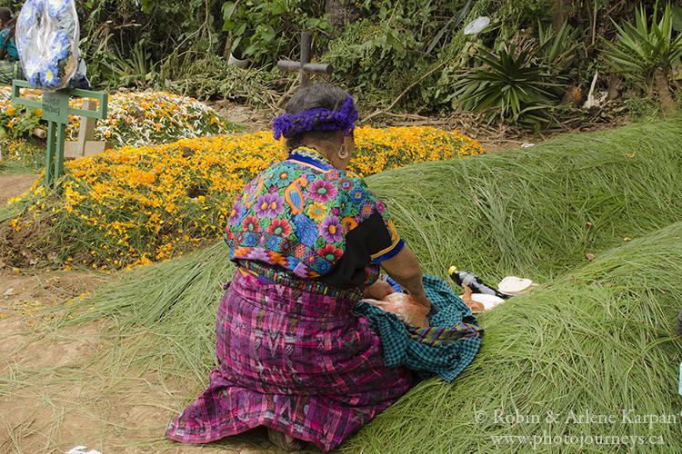 Sprucing up graves on November 1, Sumpango, Guatemala